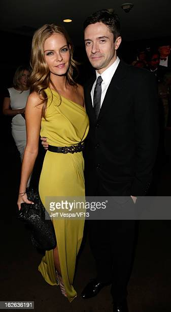 Actor Topher Grace and guest attend the 2013 Vanity Fair Oscar Party hosted by Graydon Carter at Sunset Tower on February 24 2013 in West Hollywood...