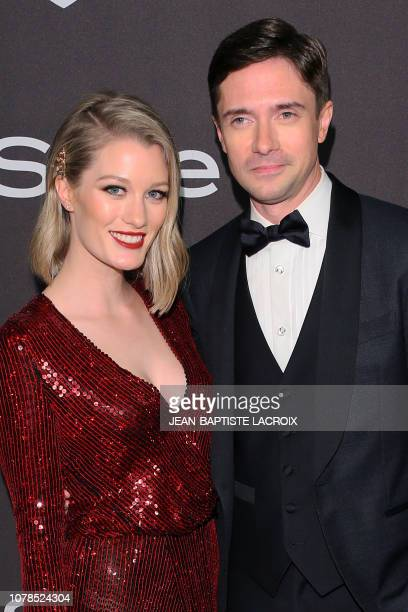 US actor Topher Grace and his wife US actress Ashley Hinshaw arrive for the Warner Bros and In Style 20th annual post Golden Globes party at the...