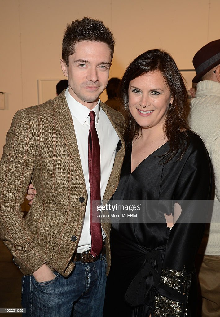 Actor Topher Grace and Jennifer Howell attend the Art Of Elysium's 6th Annual Pieces Of Heaven powered by Ciroc Ultra Premium Vodka at the Ace Museum on February 20, 2013 in Los Angeles, California.