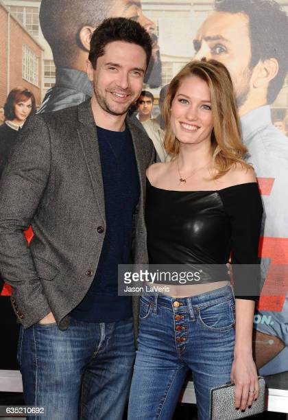 Actor Topher Grace and wife Ashley Hinshaw attend the premiere of 'Fist Fight' at Regency Village Theatre on February 13 2017 in Westwood California
