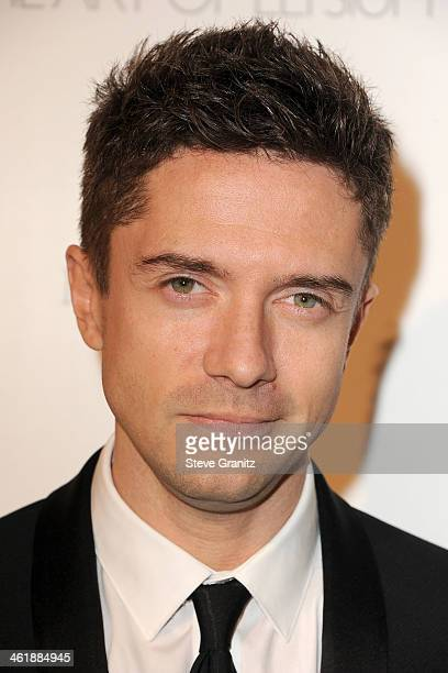 Actor Topher Grace arrives at The Art of Elysium's 7th Annual HEAVEN Gala presented by Mercedes-Benz at Skirball Cultural Center on January 11, 2014...