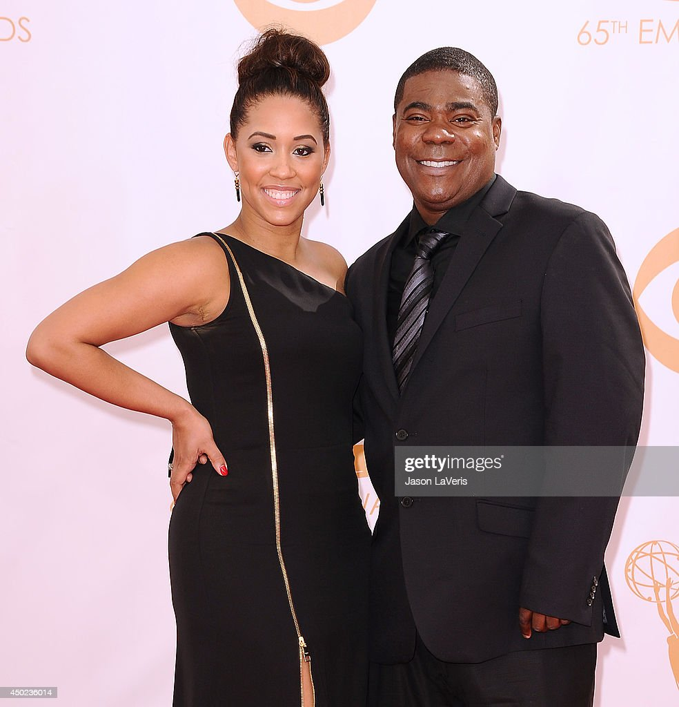 Actor Tracy Morgan (R) and Megan Wollover attend the 65th annual Primetime Emmy Awards at Nokia Theatre L.A. Live on September 22, 2013 in Los Angeles, California.