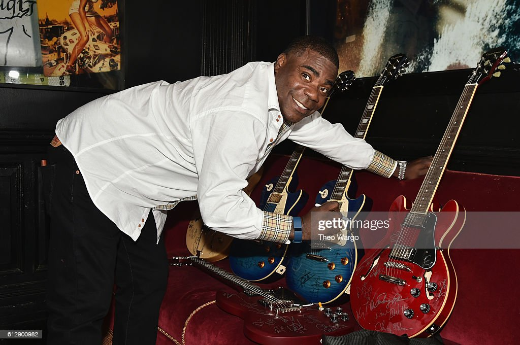 Actor Tracy Morgan autographs guitars backstage during Little Kids Rock Benefit 2016 at Capitale on October 5, 2016 in New York City.