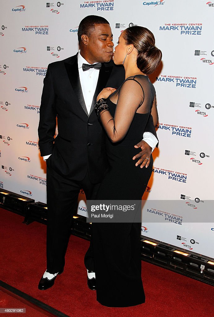 Actor Tracy Morgan gives his wife Megan Morgan a kiss at the 18th Annual Mark Twain Prize for Humor at The John F. Kennedy Center for Performing Arts on October 18, 2015 in Washington, DC.