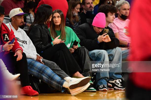 Actor Travis Bennett, Models Kendall Jenner, Haley Bieber and Singer Justin Bieber takes in the game of the Phoenix Suns against the Los Angeles...