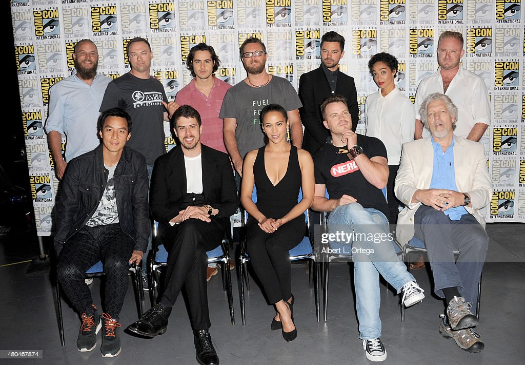 Actor Travis Fimmel, producer Thomas Tull, actor Ben Schnetzer, director Duncan Jones, actors Dominic Cooper, Ruth Negga, and Ben Foster; (L-R front row) actors Daniel Wu, Toby Kebbell, Paula Patton, Rob Kazinsky, and Clancy Brown pose at the Legendary Pictures panel during Comic-Con International 2015 the at the San Diego Convention Center on July 11, 2015 in San Diego, California.