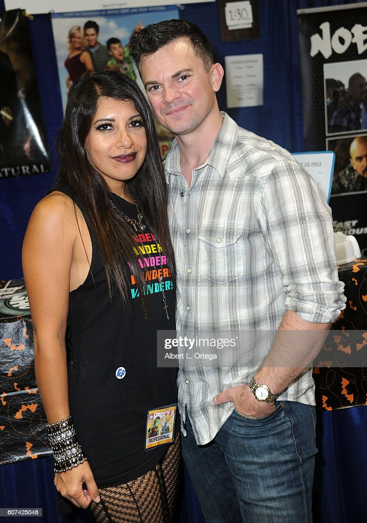 Actor Travis Wester and wife Hicxell Wester attend the Long Beach Comic Con held at Long Beach Convention Center on September 17, 2016 in Long Beach, California.