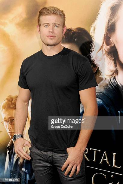 Actor Trevor Donovan arrives at the Los Angeles premiere of The Mortal Instruments City Of Bones at ArcLight Cinemas Cinerama Dome on August 12 2013...