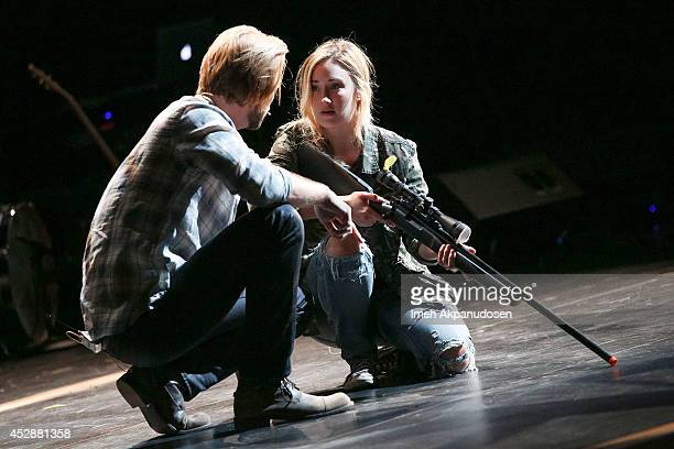 Actor Troy Baker and actress Ashley Johnson perform onstage during The Last of Us One Night Live reading and performance at The Broad Stage on July...