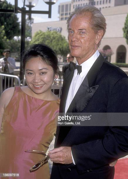 Actor Troy Donahue and date Jane Chow attend the 1998 Primetime Creative Arts Emmy Awards on August 29 1998 at Pasadena Civic Auditorium in Pasadena...