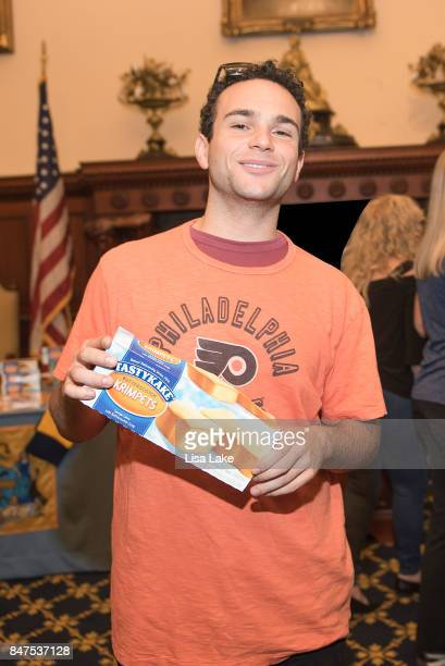 Actor Troy Gentile poses with a box of TasyKake Krimpets during an event honoring Producer Alan F Goldberg at Philadelphia City Hall on September 15...