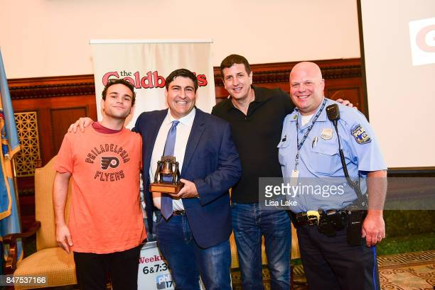 Actor Troy Gentile poses with Producer Adam F Goldberg Filmaker Doug Robinson and Police Officer George Feinstein during an event honoring Goldberg...