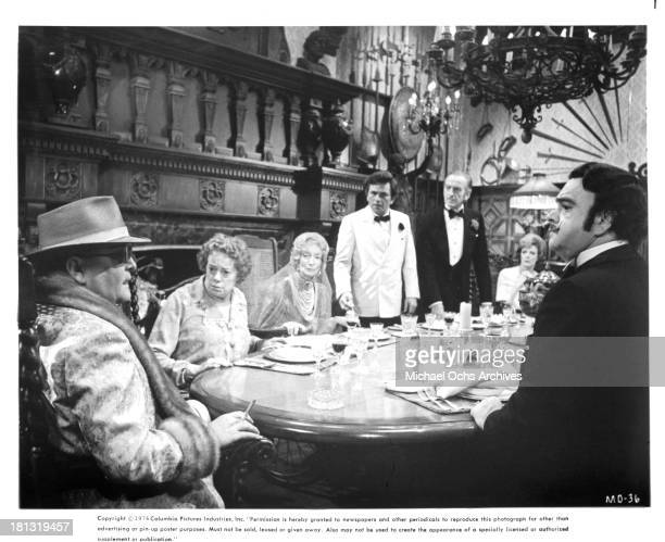 Actor Truman Capote actresses Elsa Lanchester Estelle Winwood actor Peter Falk actor David Niven actress Maggie Smith and James Coco on the set of...