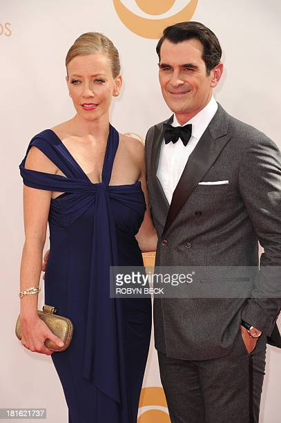 Actor Ty Burrell and his wife Holly Byrrell arrive on the red carpet for the 65th Emmy Awards in Los Angeles California on September 22 2013 AFP...