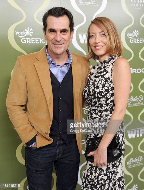 Actor Ty Burrell and Holly Burrell arrive at the Variety and Women In Film PreEmmy Party at Scarpetta on September 20 2013 in Beverly Hills California