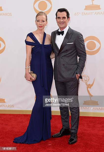 Actor Ty Burrell and wife Holly Burrell arrive at the 65th Annual Primetime Emmy Awards held at Nokia Theatre LA Live on September 22 2013 in Los...