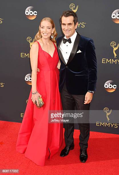 Actor Ty Burrell and wife Holly Burrell arrive at the 68th Annual Primetime Emmy Awards at Microsoft Theater on September 18 2016 in Los Angeles...