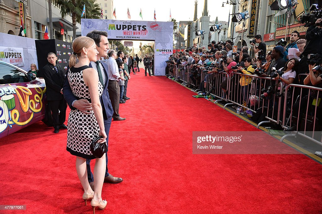 Actor Ty Burrell and wife Holly Burrell arrive for the premiere of Disney's 'Muppets Most Wanted' at the El Capitan Theatre on March 11, 2014 in Hollywood, California.