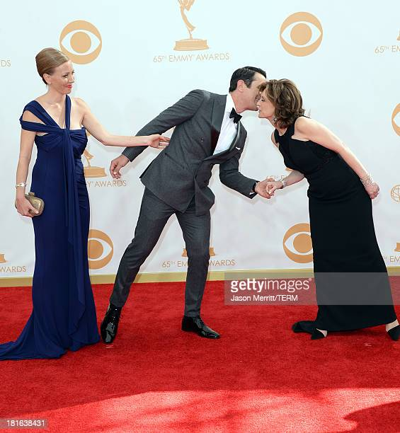 Actor Ty Burrell and wife Holly Burrell with Disney Media CoChair Anne Sweeney arrive at the 65th Annual Primetime Emmy Awards held at Nokia Theatre...
