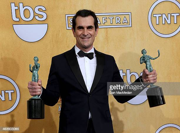 Actor Ty Burrell poses in the press room with the award for Outstanding Performance by an Ensemble in a Comedy Series for 'Modern Family' at the 20th...