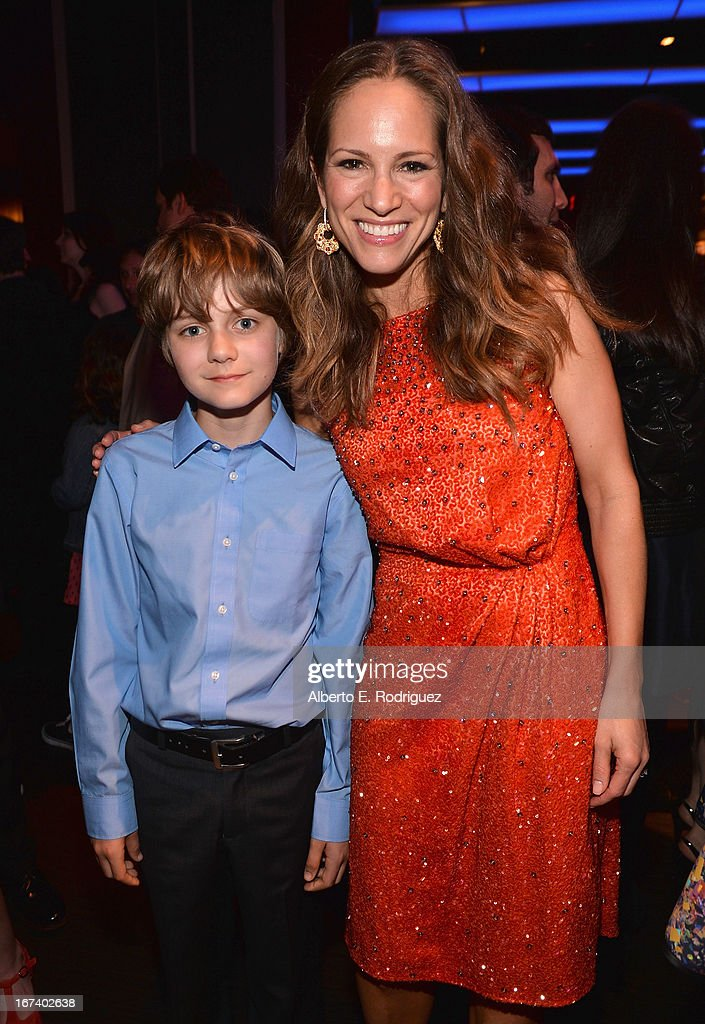 Actor Ty Simpkins and Susan Downey attend Marvel's Iron Man 3 Premiere after party at Hard Rock Cafe on April 24, 2013 in Hollywood, California.