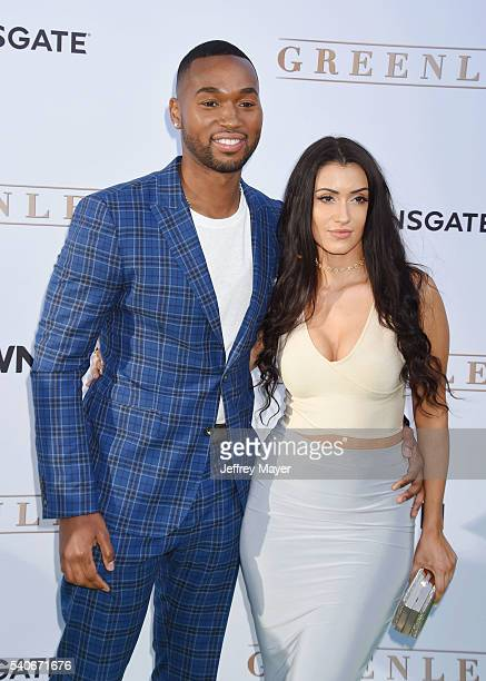 Actor Ty White and guest arriveat the premiere of OWN's 'Greenleaf' at The Lot on June 15 2016 in West Hollywood California