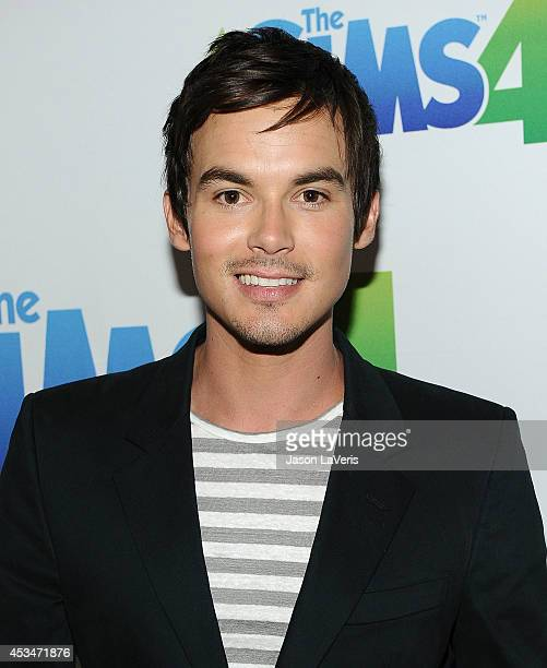 Actor Tyler Blackburn poses in the green room at the 2014 Teen Choice Awards at The Shrine Auditorium on August 10, 2014 in Los Angeles, California.