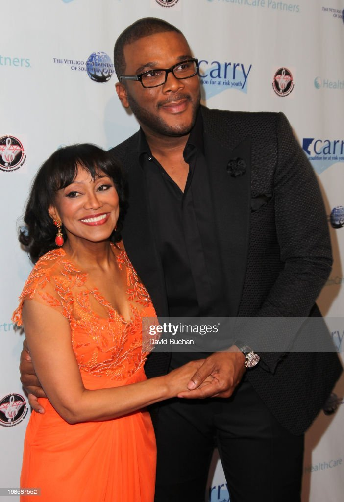 Actor Tyler Perry (R) and Dr. Pearl E. Grimes attend The Coalition For At-Risk Youth (CARRY) 'Shall We Dance' Gala at The Beverly Hilton Hotel on May 11, 2013 in Beverly Hills, California.