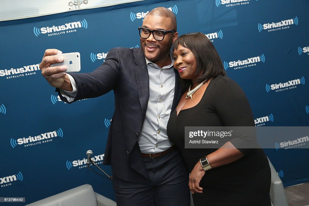 Actor Tyler Perry (L) and television personality Bevy Smith pose during SiriusXM's 'Town Hall' With Tyler Perry at SiriusXM Studios on October 10, 2016 in New York City.