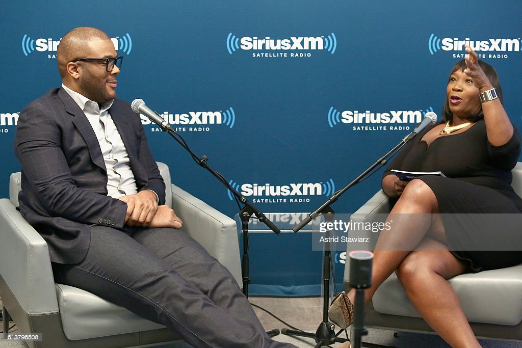 Actor Tyler Perry (L) and television personality Bevy Smith speak during SiriusXM's 'Town Hall' With Tyler Perry at SiriusXM Studios on October 10, 2016 in New York City.