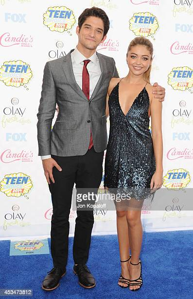 Actor Tyler Posey and actress Sarah Hyland arrive at the 2014 Teen Choice Awards at The Shrine Auditorium on August 10, 2014 in Los Angeles,...