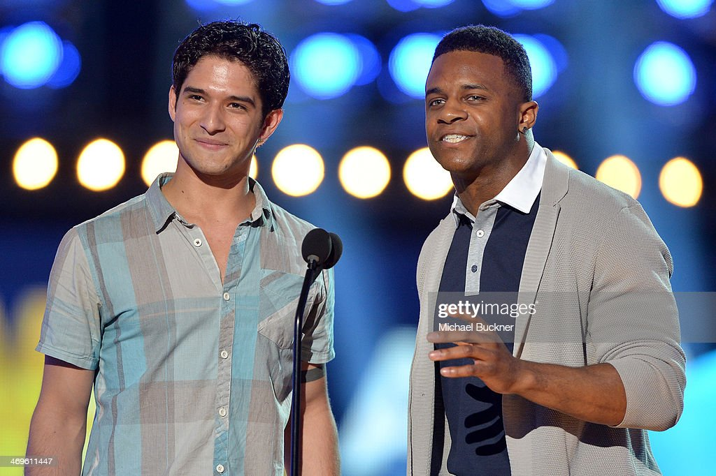 Actor Tyler Posey (L) and NFL player Randall Cobb of the Green Bay Packers speak onstage during Cartoon Network's fourth annual Hall of Game Awards at Barker Hangar on February 15, 2014 in Santa Monica, California.