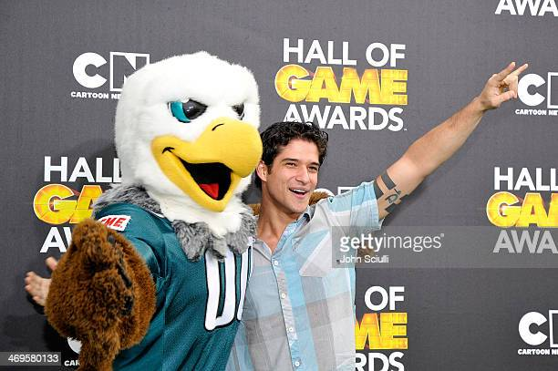 Actor Tyler Posey and Philadelphia Eagles mascot Swoop attend Cartoon Network's fourth annual Hall of Game Awards at Barker Hangar on February 15...