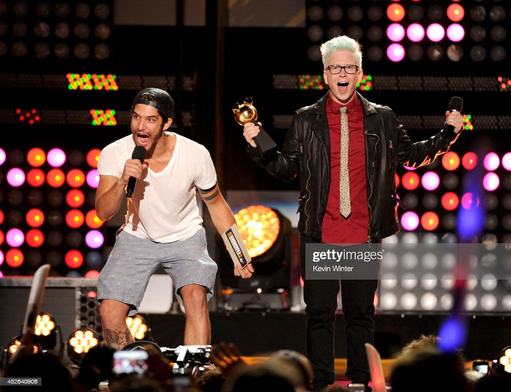 Actor Tyler Posey (L) and Tyler Oakley speak onstage at the MTVu Fandom Awards during Comic-Con International 2014 at PETCO Park on July 24, 2014 in San Diego, California.