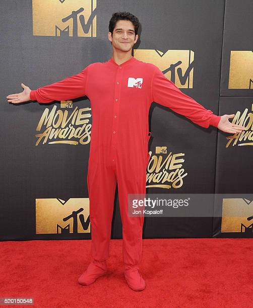 Actor Tyler Posey arrives at the 2016 MTV Movie Awards at Warner Bros Studios on April 9 2016 in Burbank California