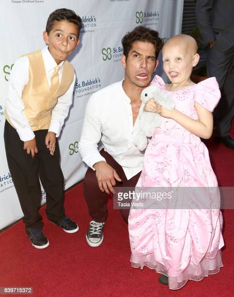 Actor Tyler Posey honoree Zein Youssef and at the 2nd Annual St Baldrick's Ever After Ball at CBS Studios on August 26 2017 in Los Angeles California