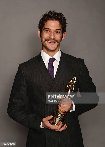 Actor Tyler Posey poses for a portrait during the 2012 NCLR ALMA Awards at Pasadena Civic Auditorium on September 16 2012 in Pasadena California
