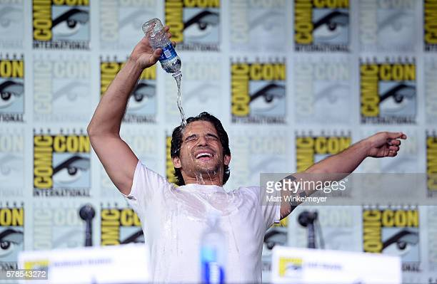 Actor Tyler Posey pours a bottle of water on himself during the 'Teen Wolf' panel during ComicCon International 2016 at San Diego Convention Center...