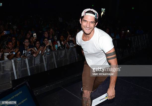 Actor Tyler Posey runs to fans at the Teen Wolf panel during ComicCon International 2016 at San Diego Convention Center on July 21 2016 in San Diego...