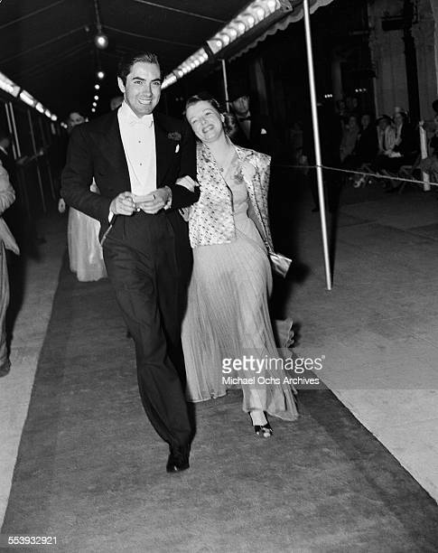 Actor Tyrone Power and actress Janet Gaynor attend an event in Los Angeles California