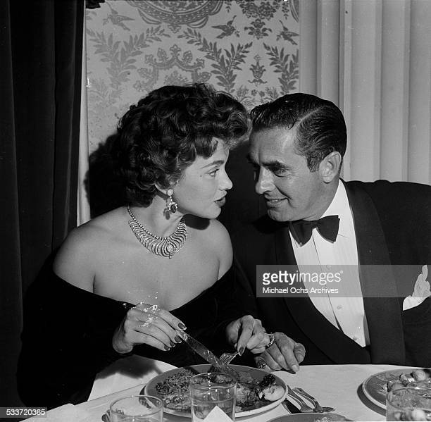 Actor Tyrone Power and his wife actress Linda Christian attend Jack Benny's wedding in Los AngelesCA