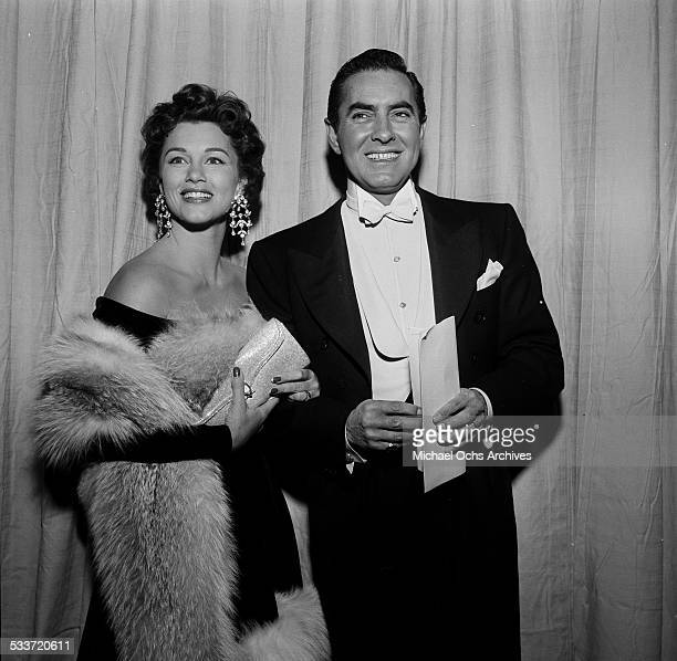 Actor Tyrone Power and his wife actress Linda Christian attend the Academy Awards in Los AngelesCA