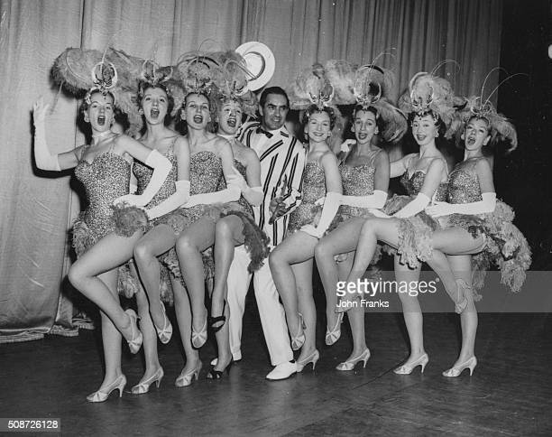 Actor Tyrone Power posing with a row of chorus girls Peggy Cummins Anne Massey Sheila Sim Joan Sims Jean Kent Thelma Ruby Dulcie Grey and Brenda...