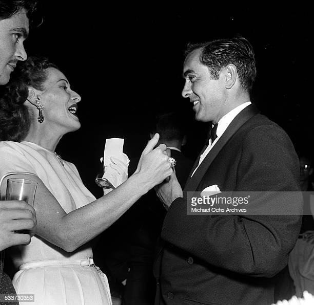 Actor Tyrone Power talks with actress Maureen O'Hara during the CBS party of the Ed Sullivan Show in Los AngelesCA