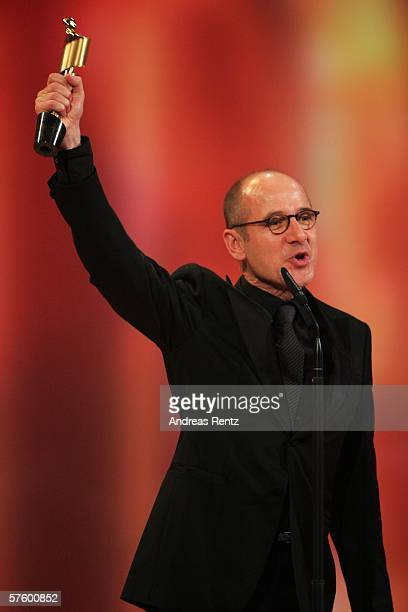 Actor Ulrich Muehe holds his award as the best actor at the German Film Awards at the Palais am Funkturm May 12, 2006 in Berlin, Germany.
