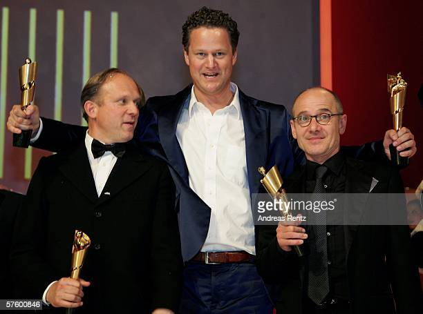 Actor Ulrich Tukur screenwriter and director Florian Henckel von Donnersmarck and Ulrich Muehe pose with their awards at the German Film Awards at...