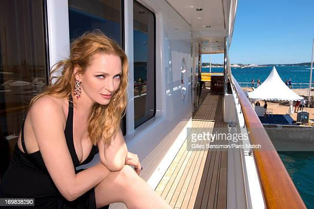 Actor Uma Thurman wearing a a dress by Armani and jewellery by Orlov is photographed for Paris Match on May 24 2013 in Cannes France