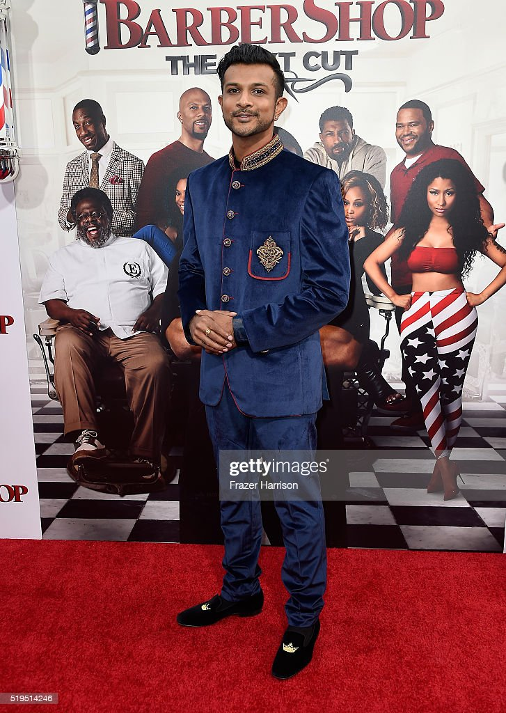 Actor Utkarsh Ambudkar attends the Premiere Of New Line Cinema's 'Barbershop: The Next Cut' at TCL Chinese Theatre on April 6, 2016 in Hollywood, California.
