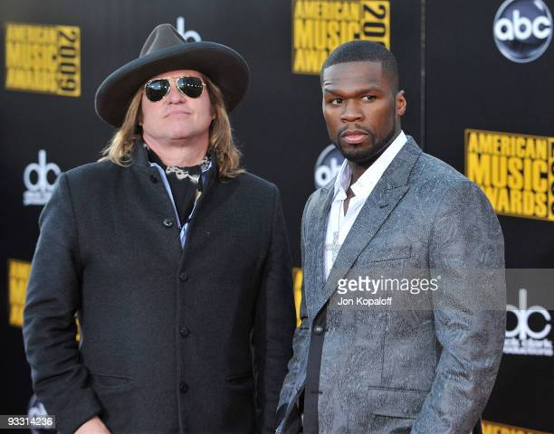 Actor Val Kilmer and Rapper 50 Cent arrive at Nokia Theatre LA Live on November 22 2009 in Los Angeles California