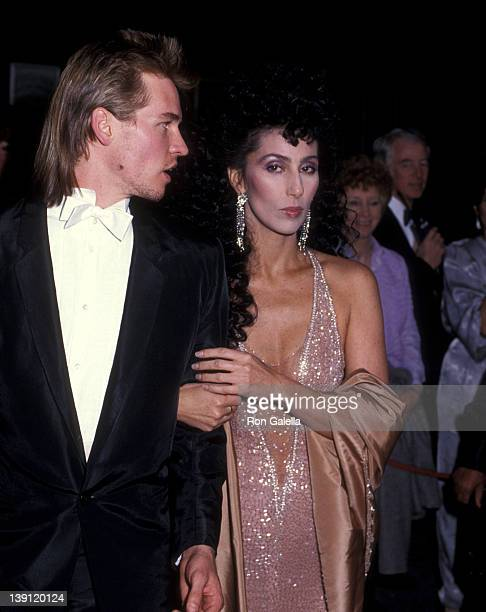 Actor Val Kilmer and singer/actress Cher attend the 56th Annual Academy Awards on April 9 1984 at Dorothy Chandler Pavilion Los Angeles Music Center...